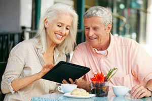 senior-couple-using-bible-app-on-tablet