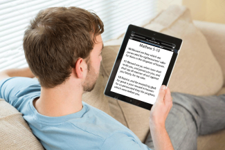 guy-on-sofa-with-tablet